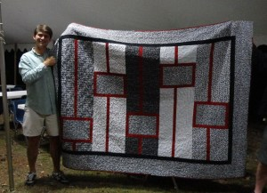 Clint with graduation quilt