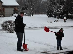 Dustin and Aidan shoveling snow