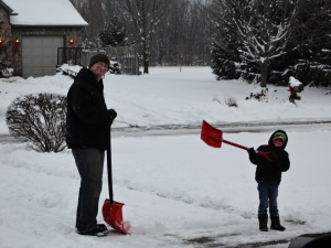 Dustin and Aidan shoveling snow