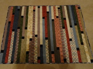 zippy strippy quilt with black blocks