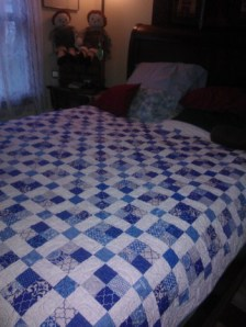 blue and white on bed